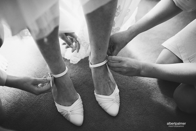 cool wedding photo of bride putting her shoes on