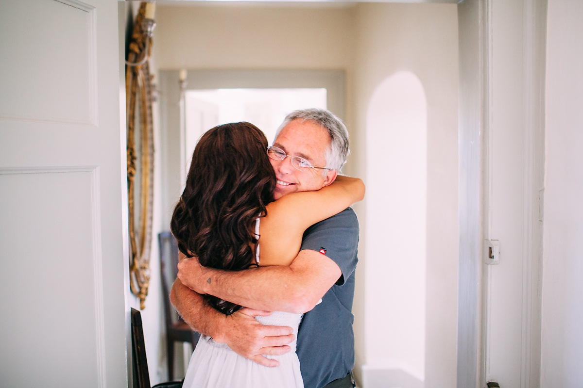 documentary photo of bride and father hugging before wedding
