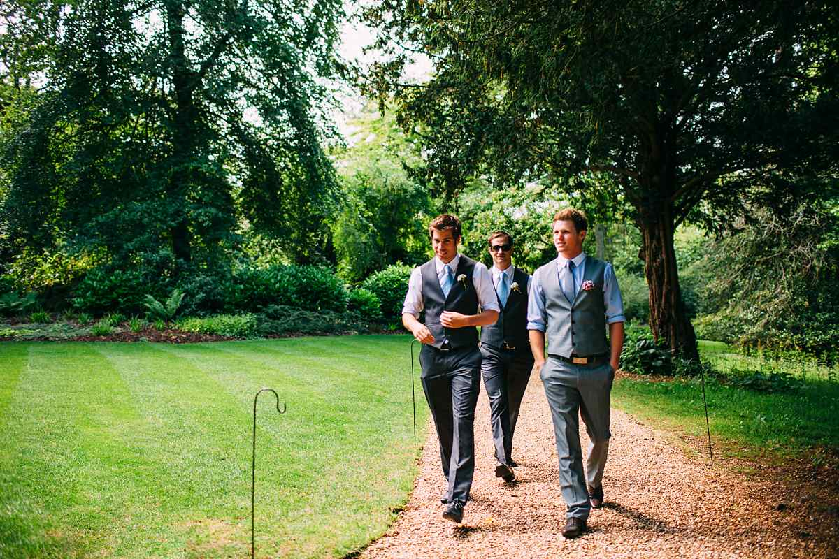 groom and ushers walking around larmer tree gardens before the ceremony