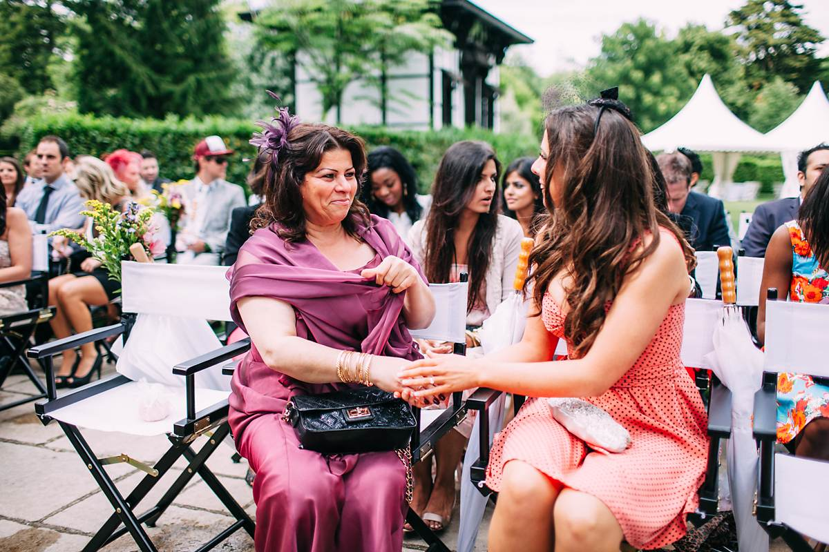 mother of the bride sat outdoors for wedding
