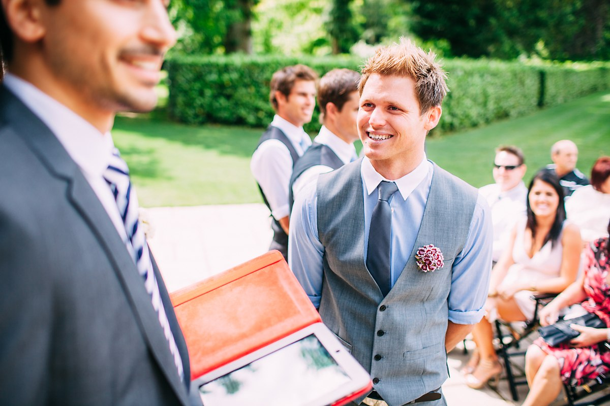groom smiling at fun wedding at larmer tree gardens