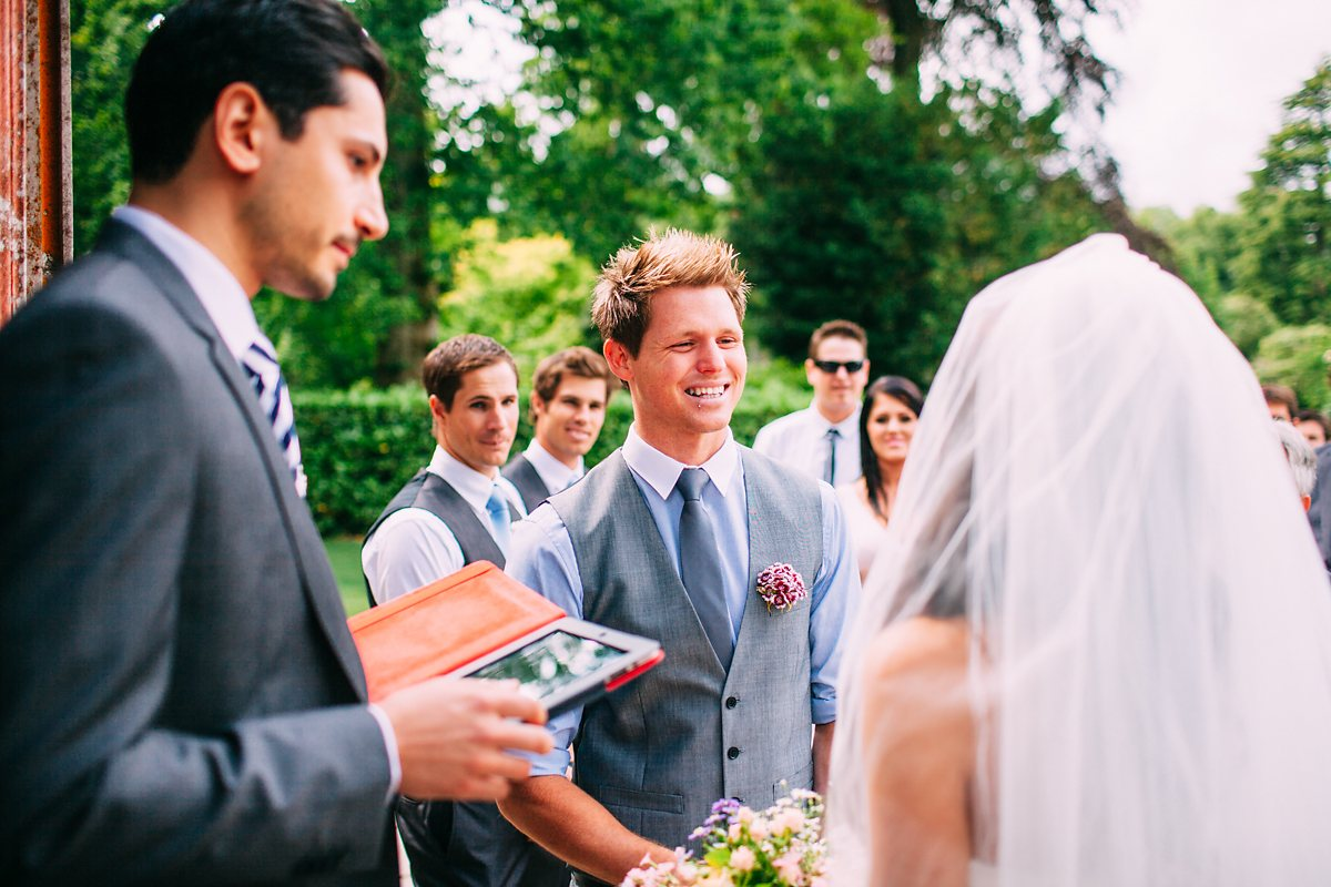 groom smiling at outdoor wedding ceremony