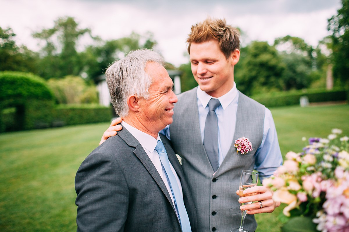 groom and dad hugging