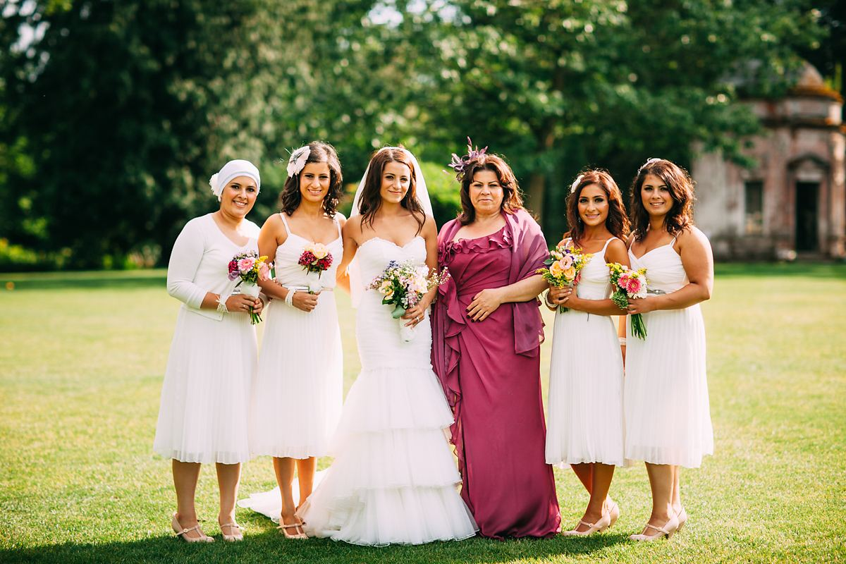 photo of the bride and her mum and sisters at a wedding at larmer tree gardens