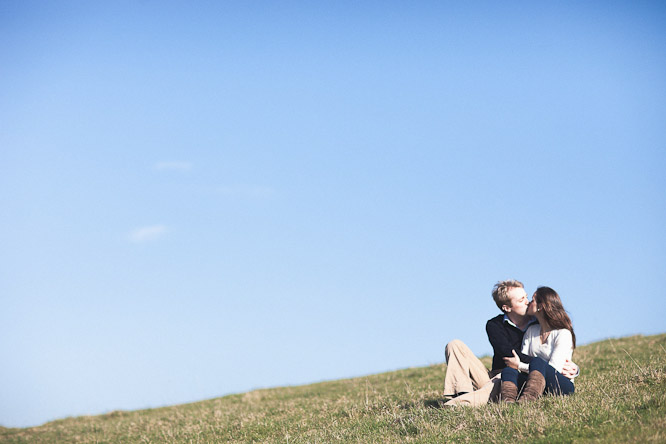 photo of tim and lucy on a green hill in the spring