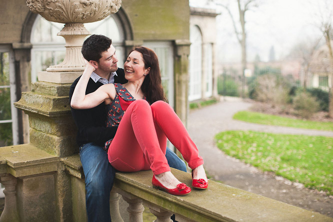 cool red shoes in an engagement shoot