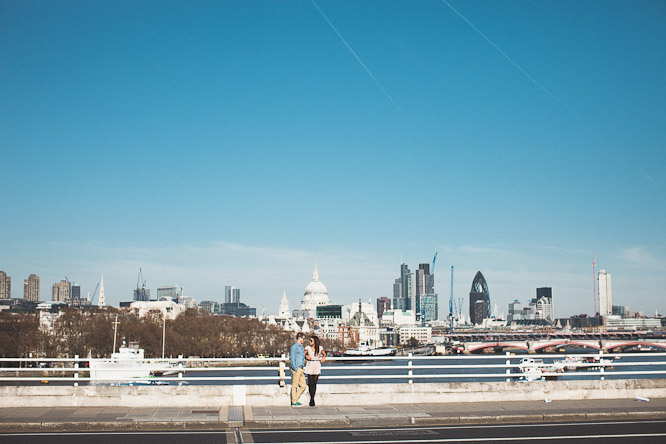 couple on waterloo bridge on their engagement shoot in london