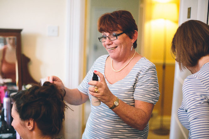 mother of the groom doing hair