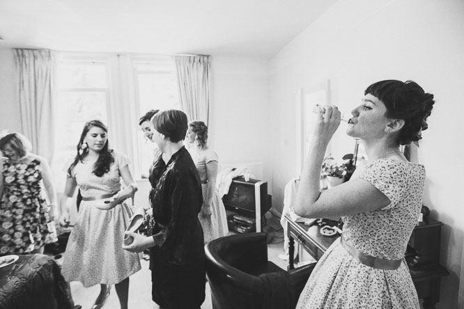 cool wedding documentary photo of bridesmaid drinking