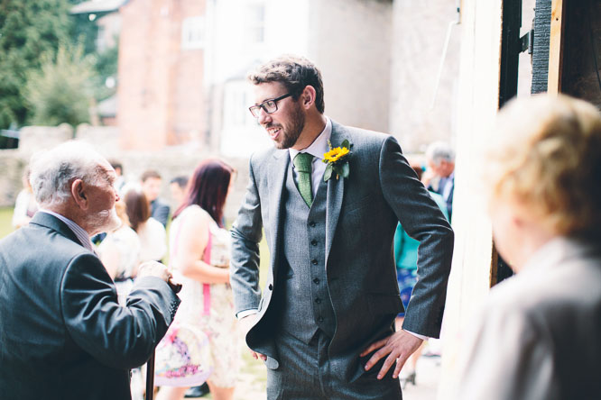 groom chatting before the ceremony at Lyde Court
