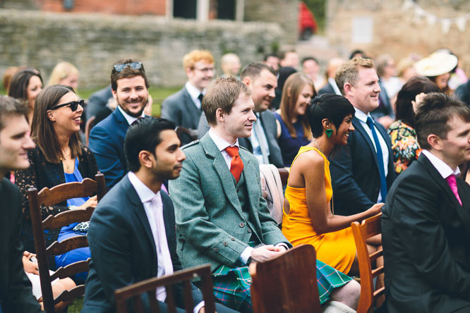 reportage wedding photo of guests at Lyde Court