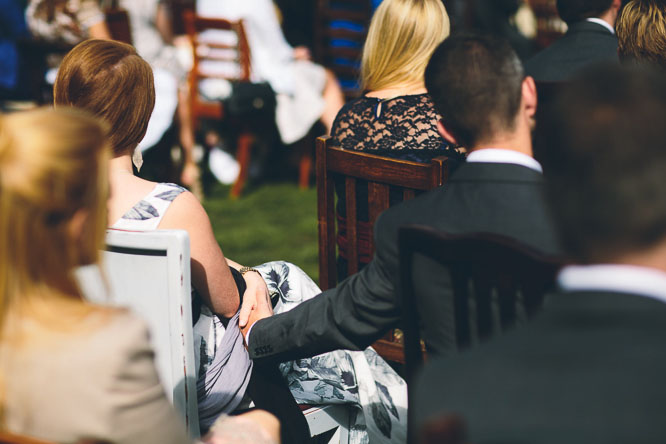 couple holding hands at wedding ceremony