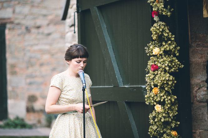 bridesmaid singing at wedding at Lyde Court