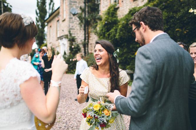 bridesmaid smiling at summer wedding