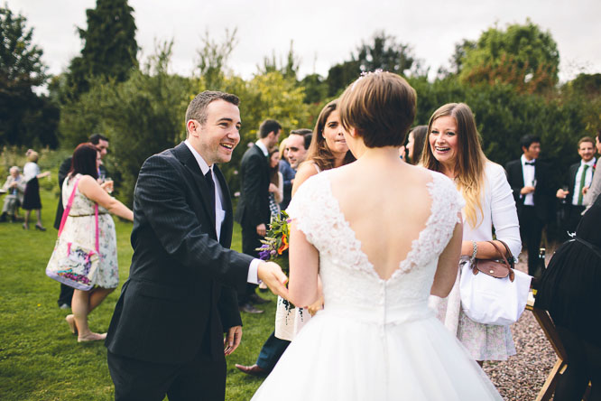 reportage wedding photo of bride being congratulated