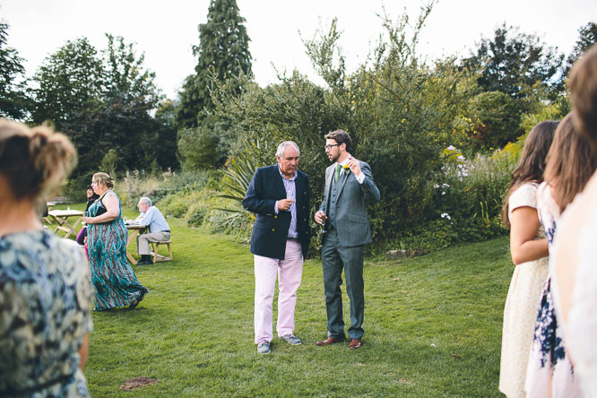 pink trousers at a wedding