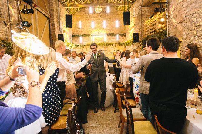 couple enter the wedding reception
