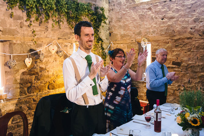 guests giving applause at Lyde Court wedding