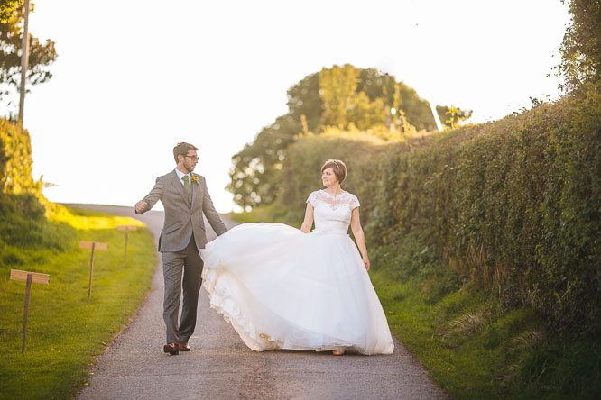 jennie and dom walk down road of Lyde Court
