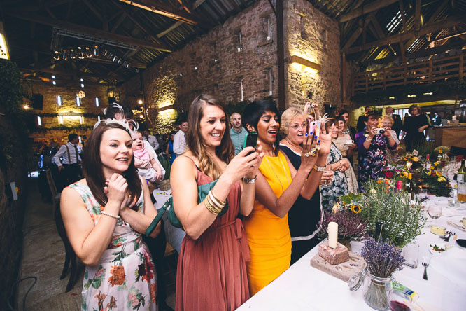 guests clap at Lyde Court wedding