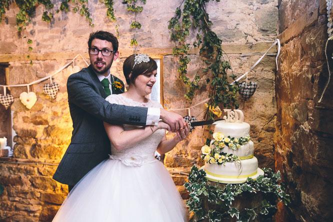 jennie and dom cut their wedding cake