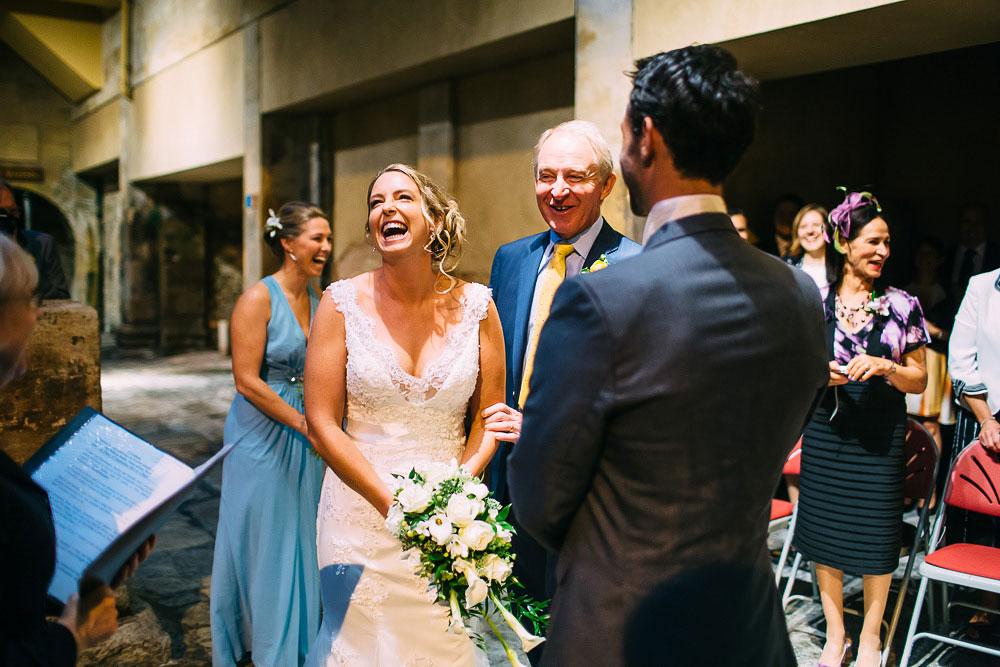 bride laughing at roman baths wedding