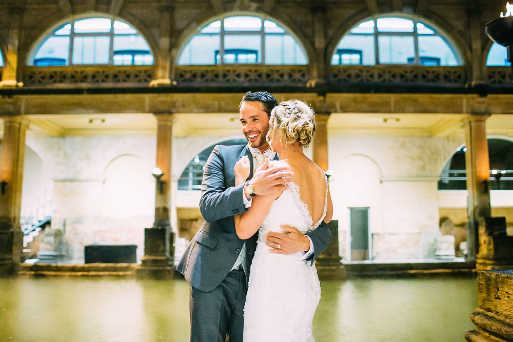 documentary wedding photo of bride and groom at roman baths wedding