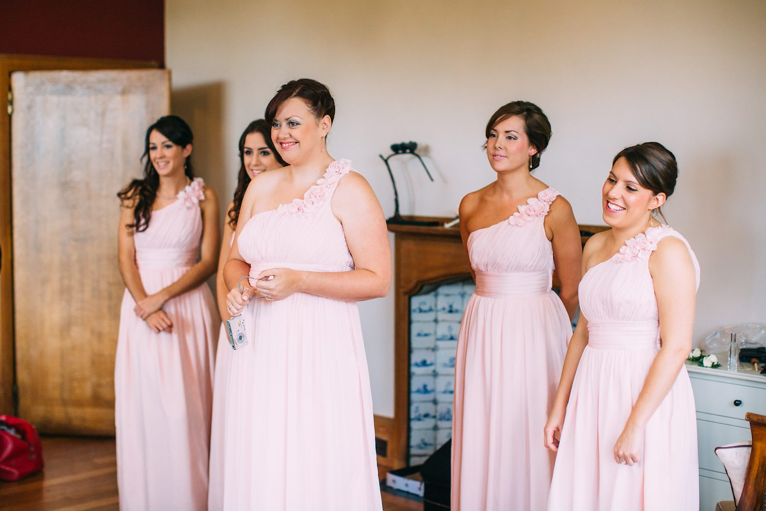 bridesmaids wearing pink dresses at Coombe Lodge Wedding