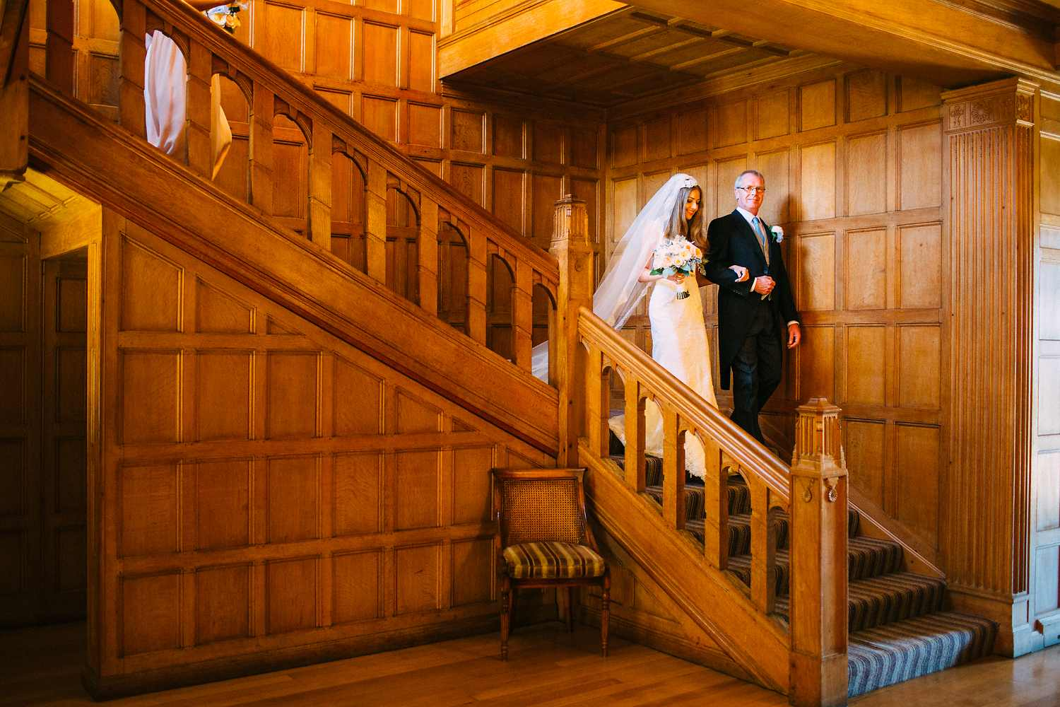 bride and father walking down the staircase in coombe lodge