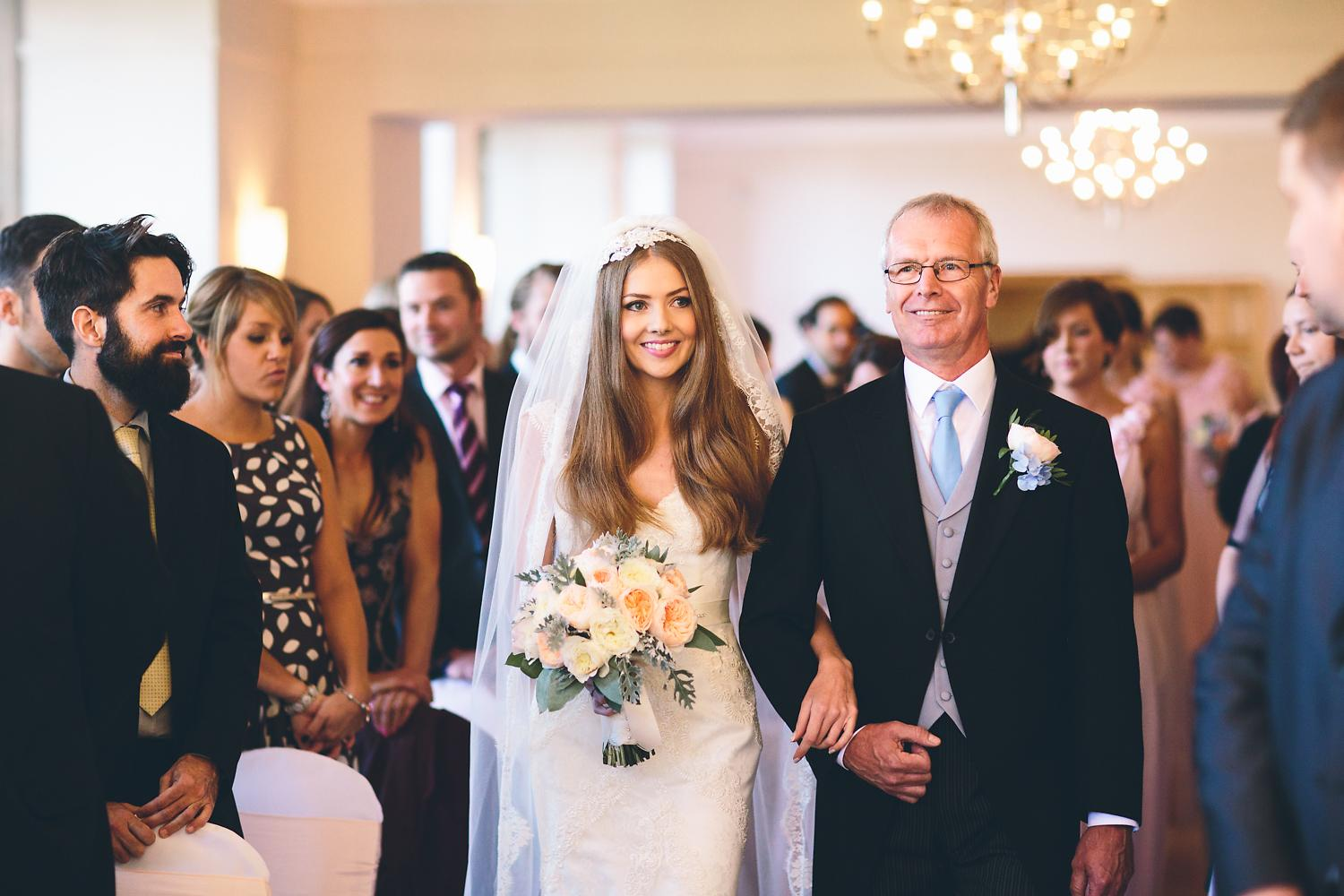 bride and father walking down the aisle at Coombe Lodge