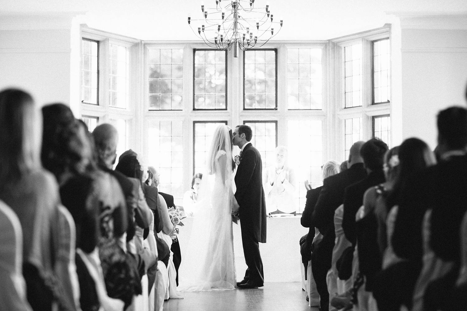 first kiss at wedding ceremony in Coombe Lodge