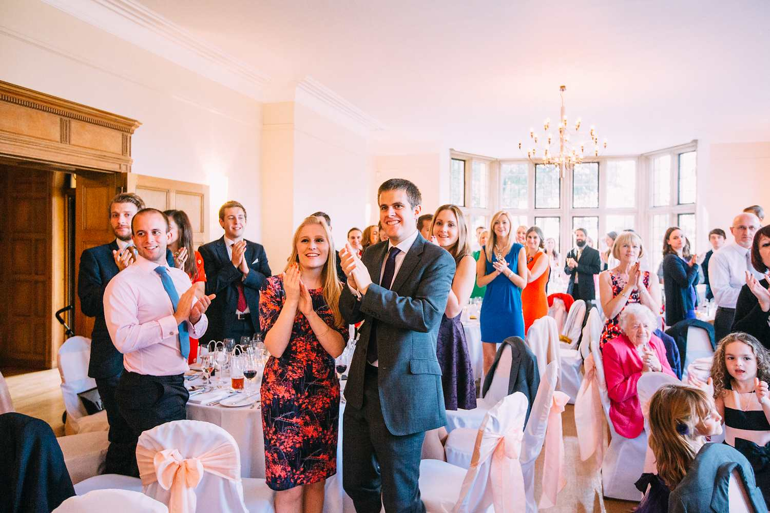 people cheering at coombe lodge wedding