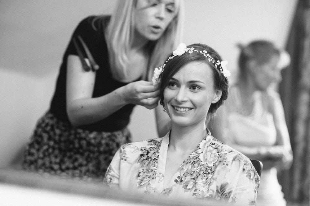 bride having her flower crown put on