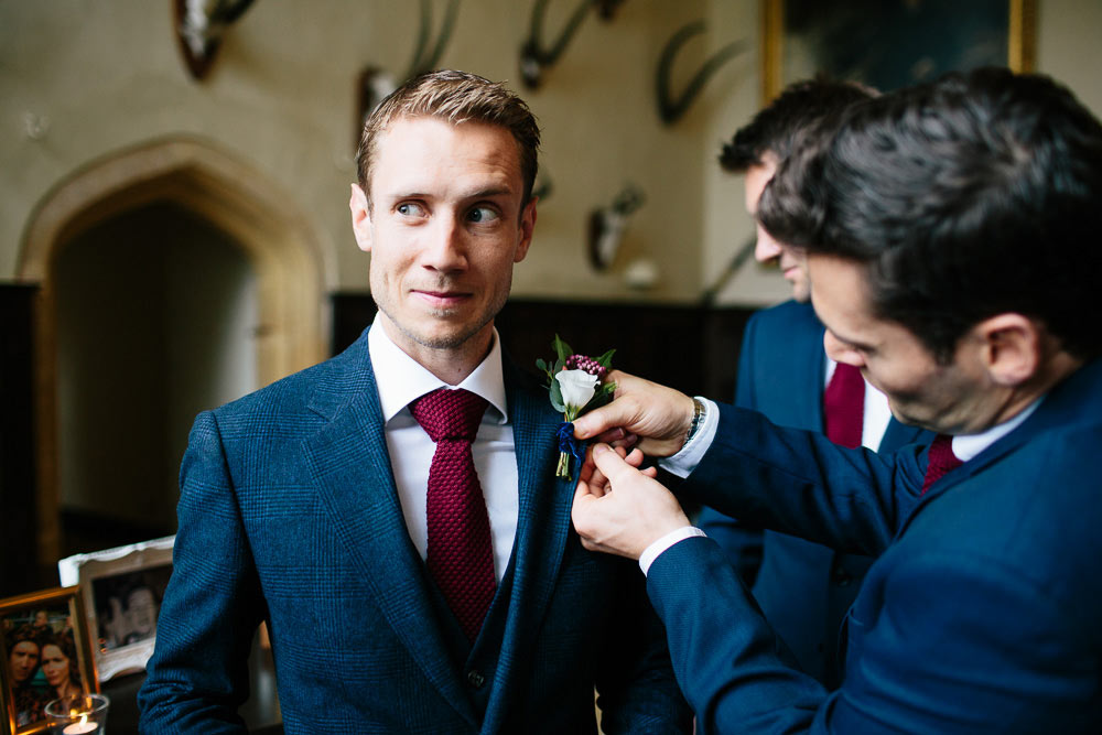 groom having his button hole attached