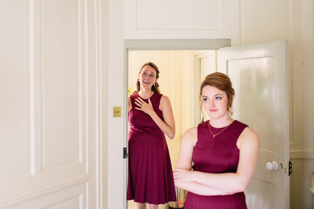 bridesmaids reaction to dress being put on