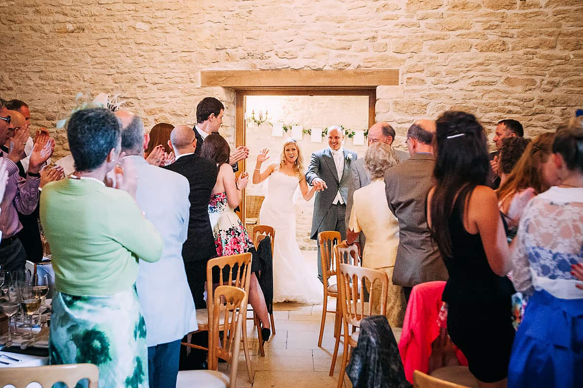 bride and groom being announced in to the room
