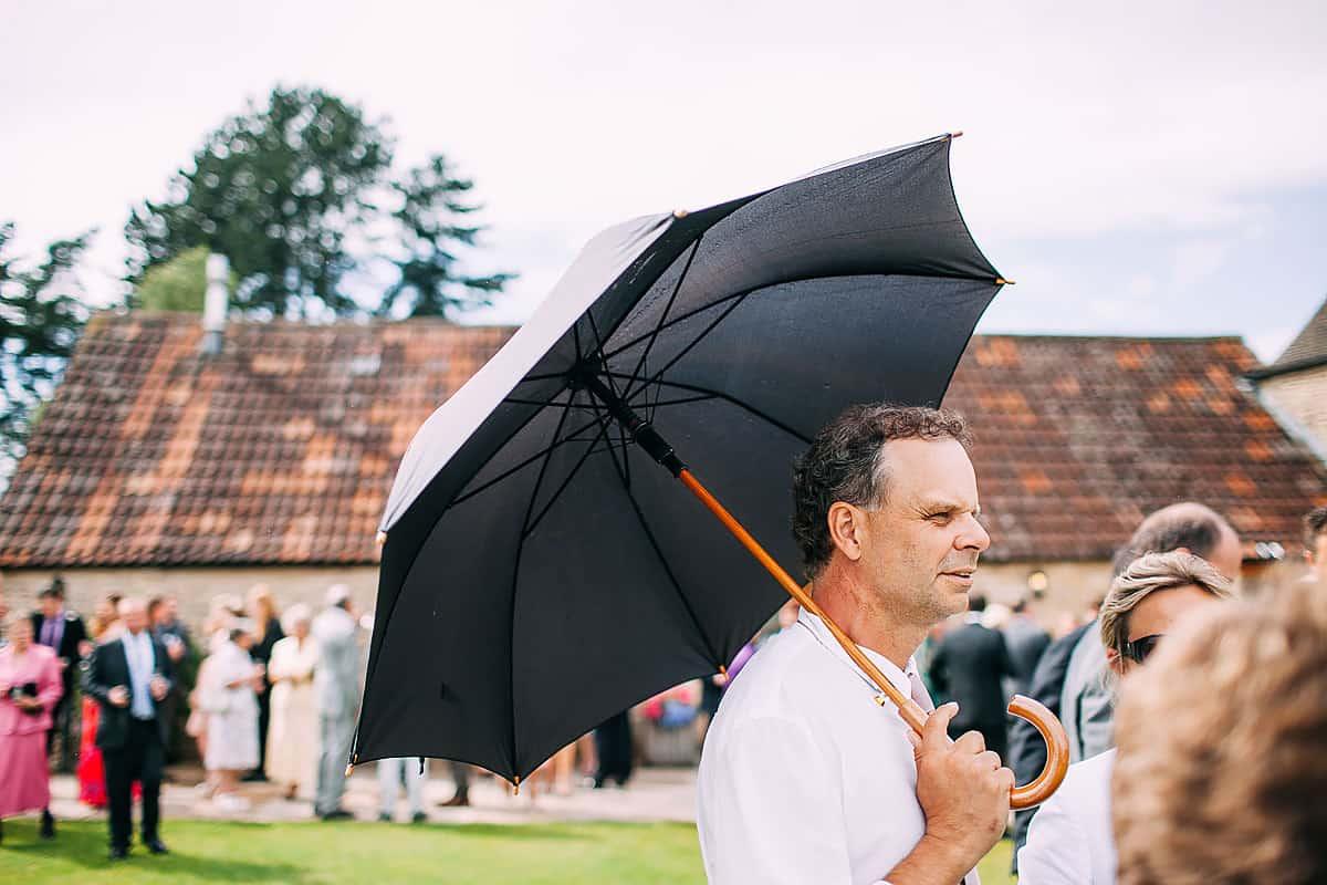 wedding guest with umbrella