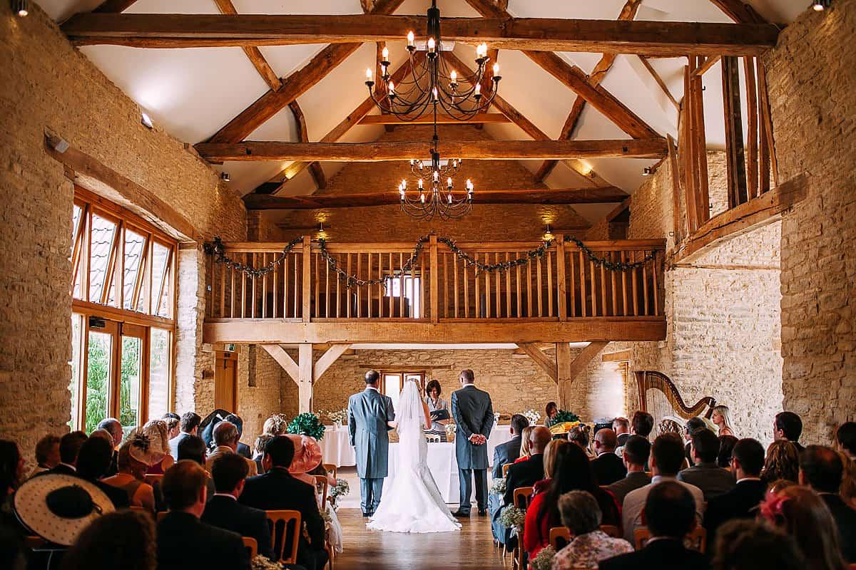 mid wedding ceremony at Kingscote Barn