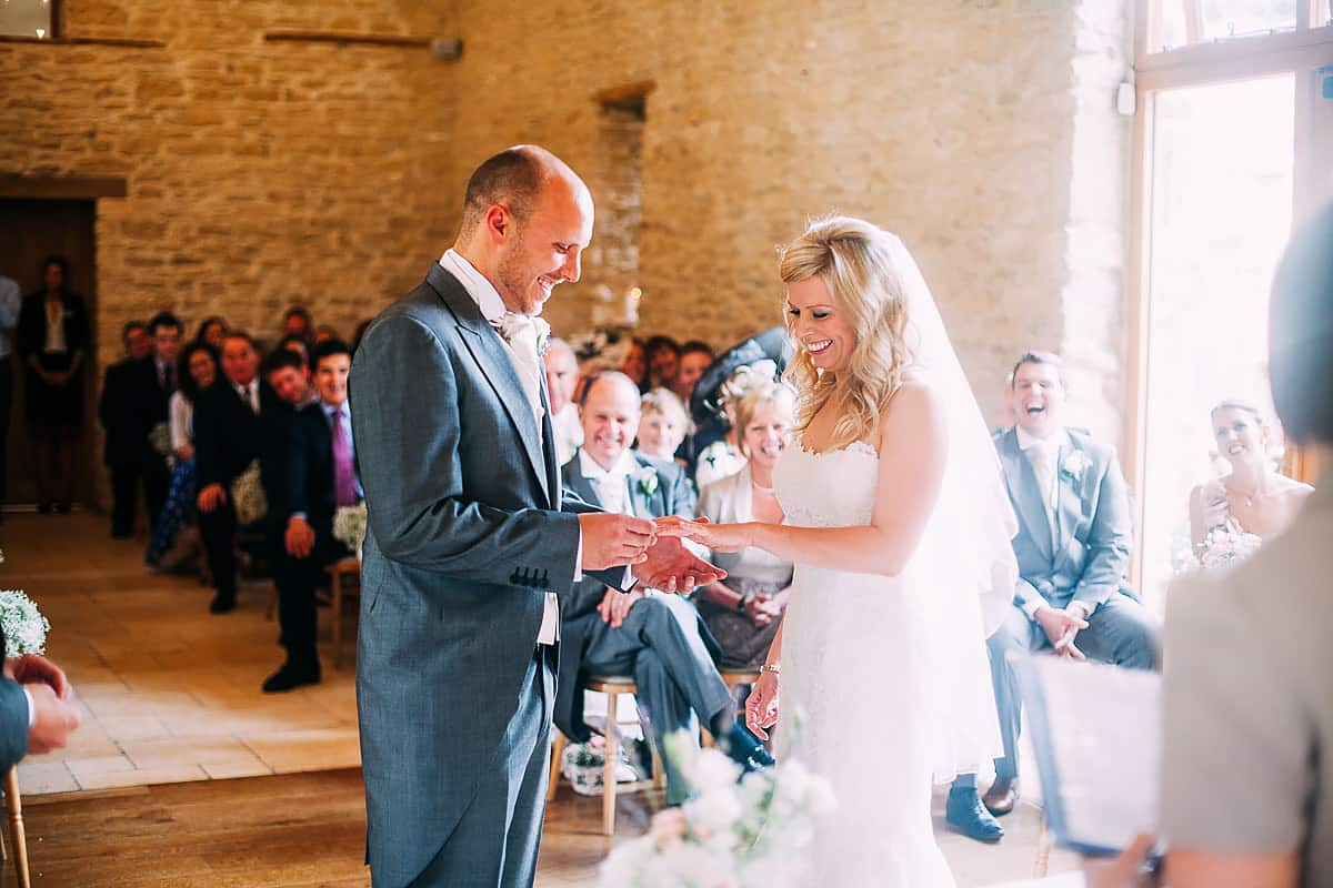 bride and groom exchanging wedding ring
