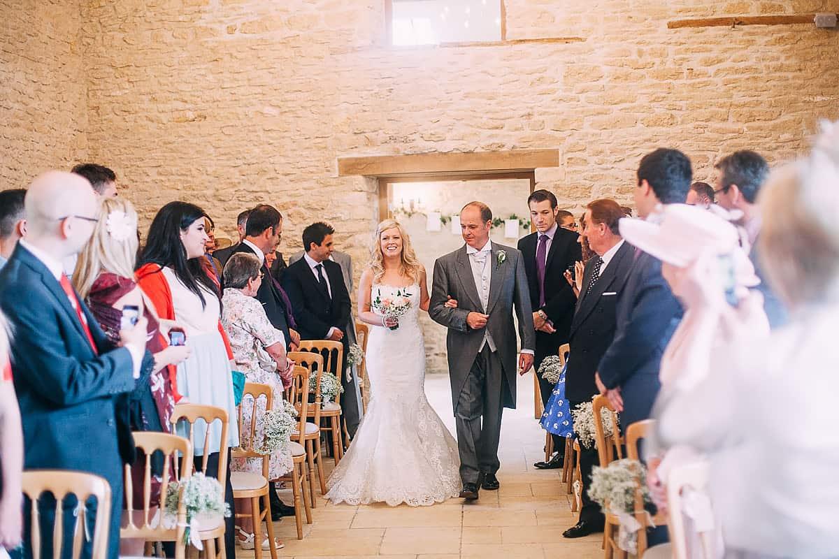bride walking down aisle Kingscote Barn