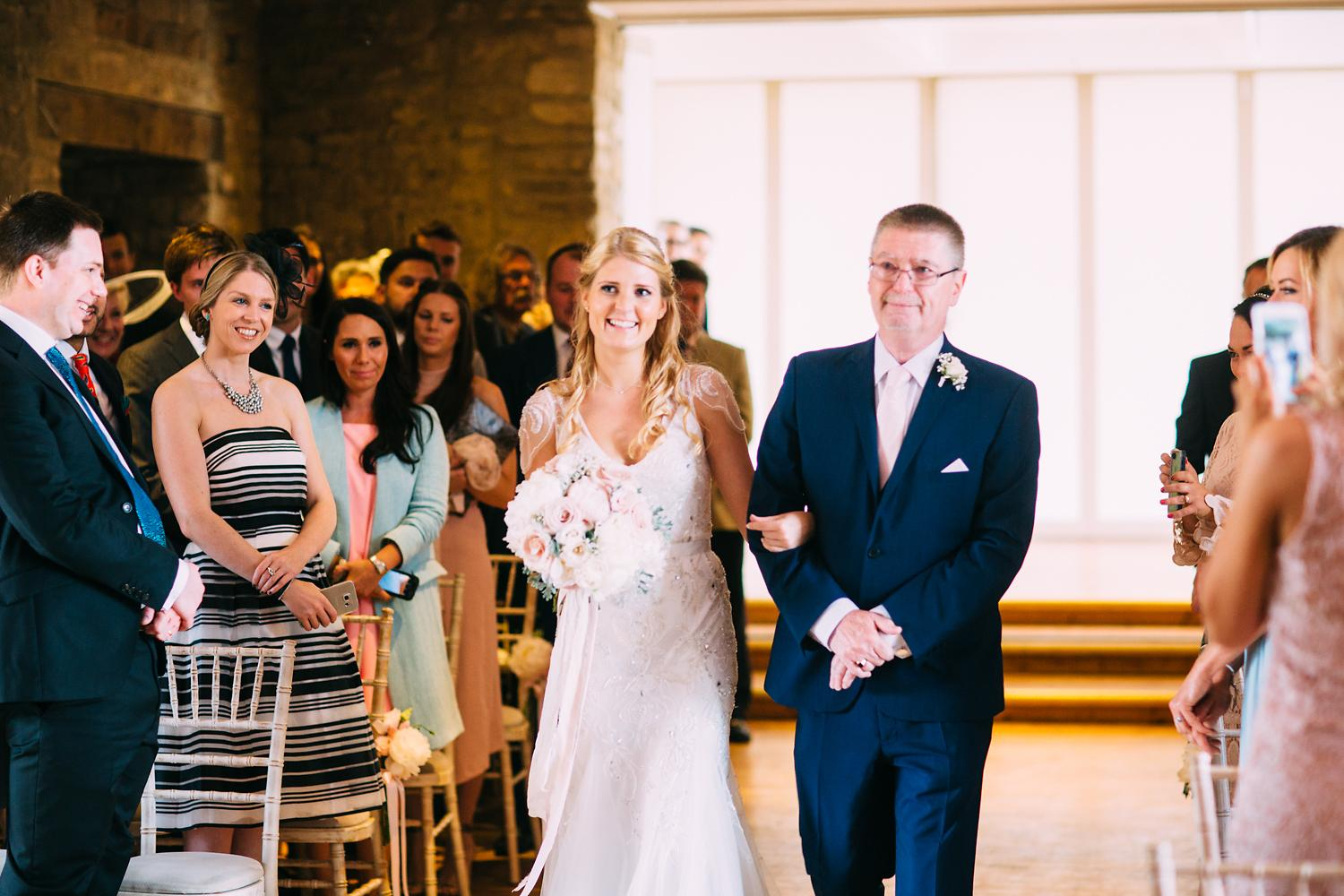 walking down aisle at Great Tythe Barn