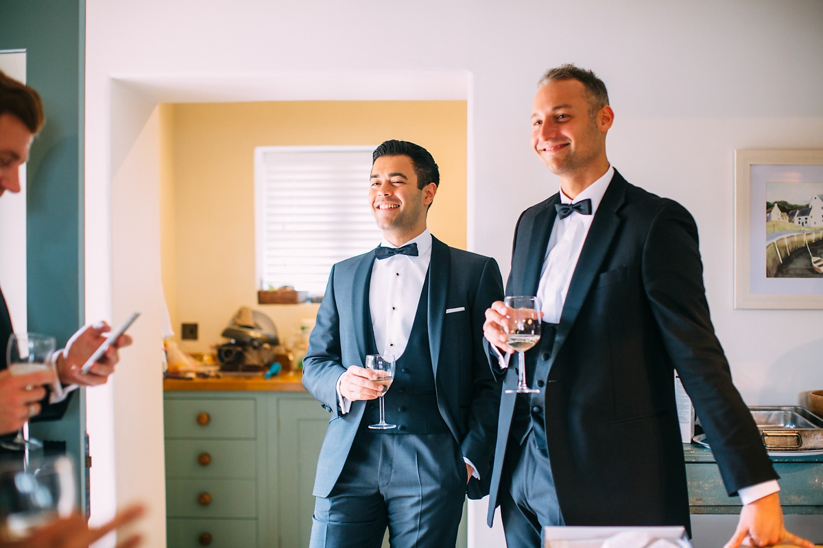 relaxed wedding photos of groomsmen at lulworth castle