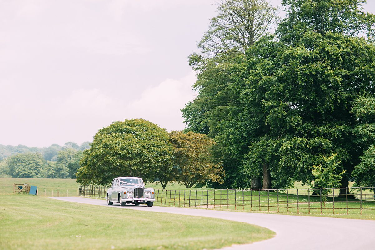 silver rolls royce wedding car