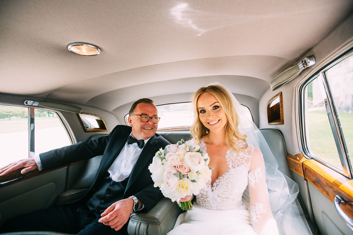bride and father in wedding car at lulworth castle wedding