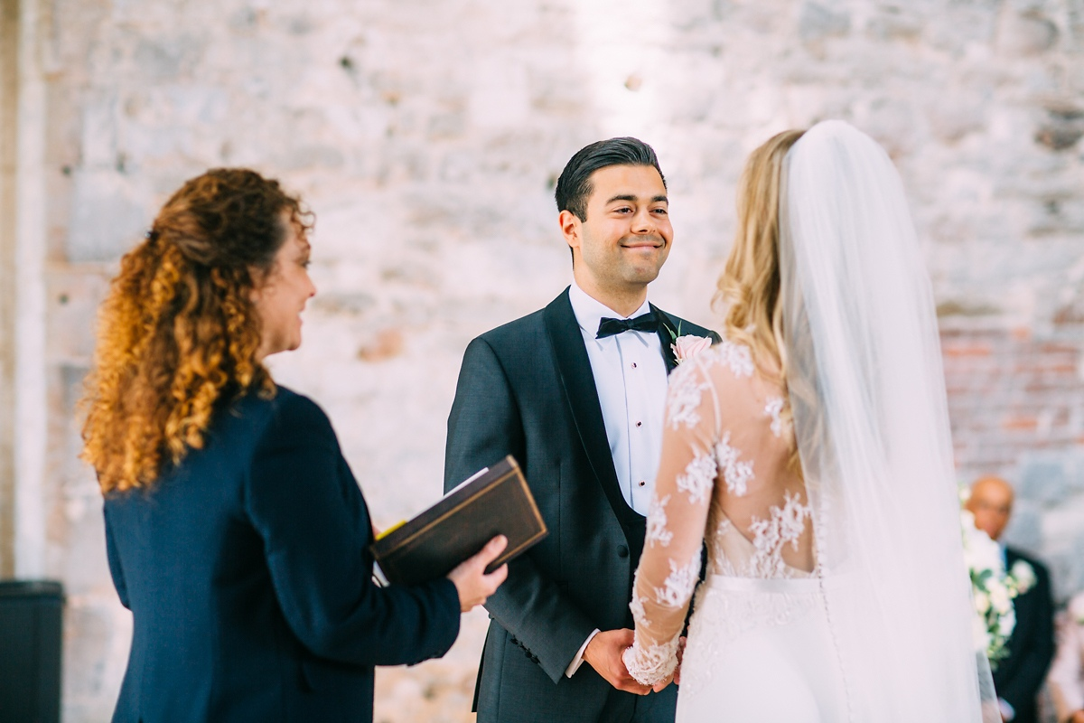 groom in tuxedo at lulworth castle wedding photographer