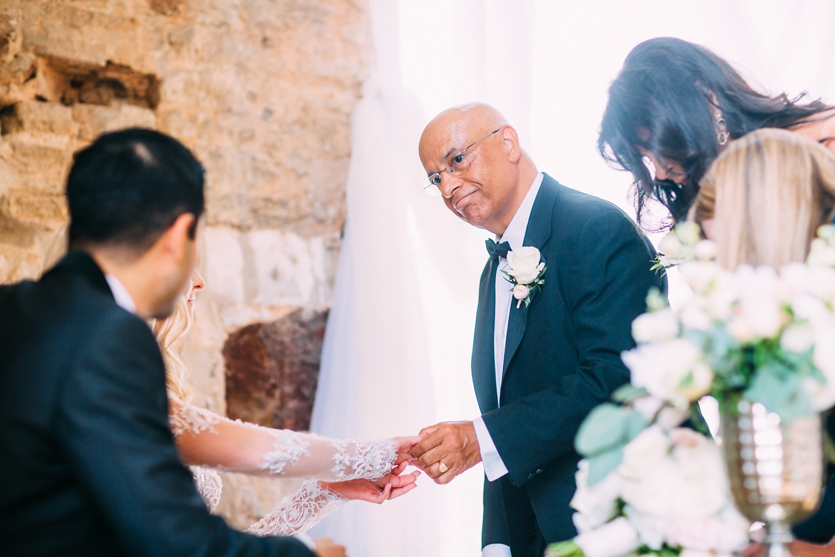 father of the groom shaking hands