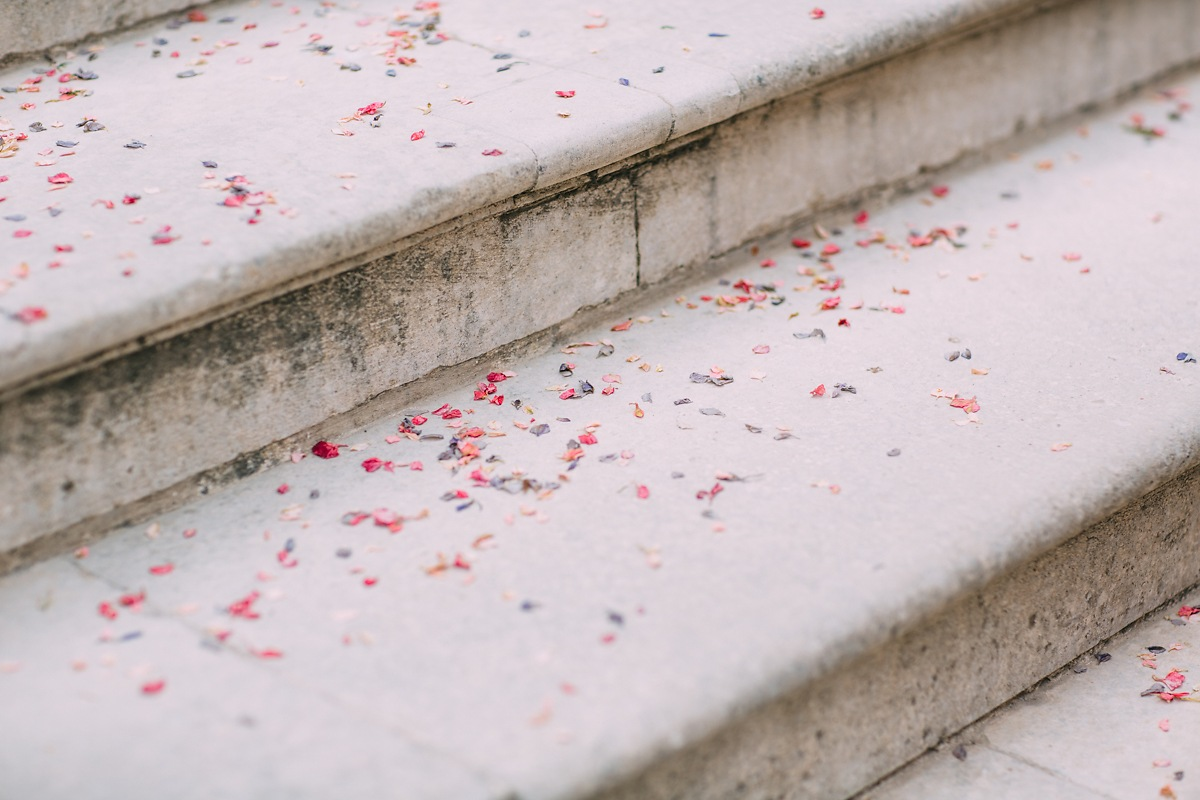 wedding confetti on the steps of lulworth castle