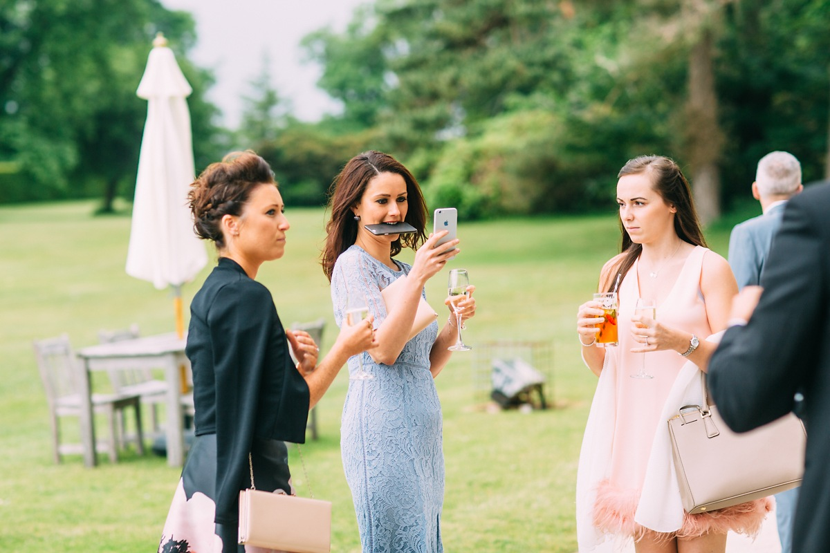 funny wedding photo of guest biting phone