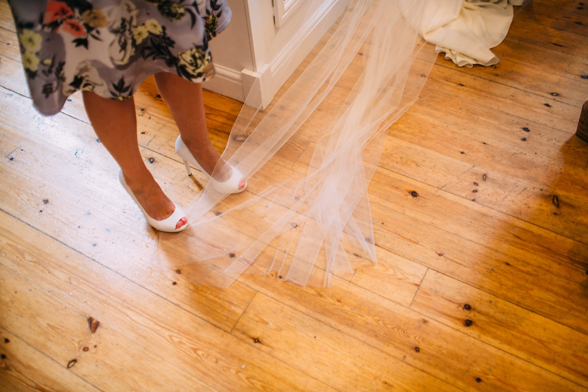 guest stepping on bride's wedding veil
