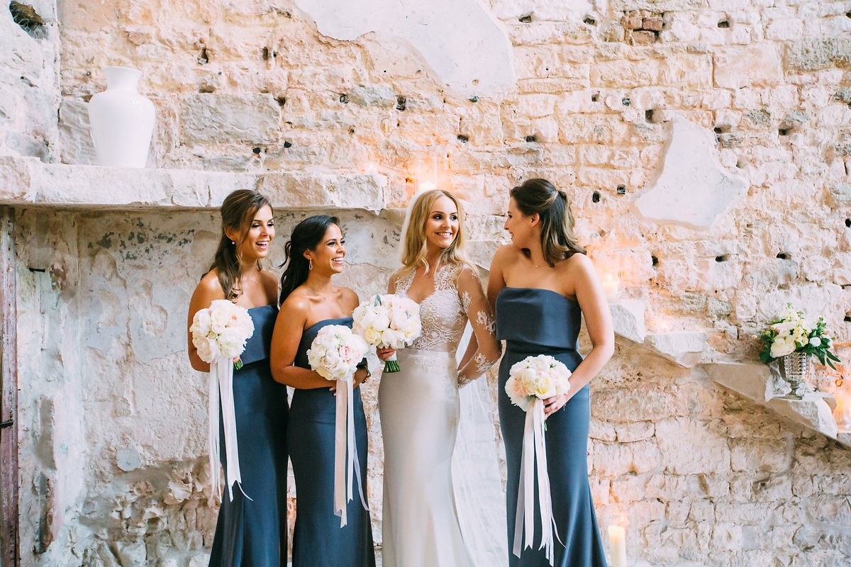 bride and bridesmaids at lulworth castle
